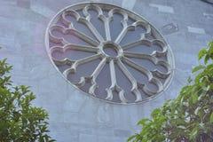Circular ornamental window on church. Circular ornamental window in store wall of Christian cathedral royalty free stock photo