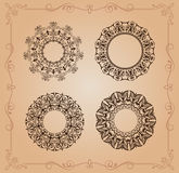 The circular ornaments mandala Vintage. Openwork black-colored mandala patterns in style art nouveau on a pink background Royalty Free Stock Images
