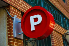 Circular Parking Sign. Lancaster, PA - August 20, 2016: A large red circular 'P' sign signifying a public parking garage Stock Photo