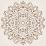 Circular pattern. Round brown lace pattern on a beige background Royalty Free Stock Photography