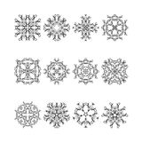 The circular pattern. Snowflakes, stars, mandala. A set of 12 elements. A set of circle lace patterns in white and black. The circular pattern. Snowflakes Stock Images