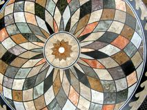 Circular patterned tabletop. Circular pattern made of ceramic tiles in a tabletop. Arcs and angles present Royalty Free Stock Photography