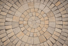 Circular Paving stone pattern. A radial of circular pattern of paving blocks viewed from above Royalty Free Stock Photos