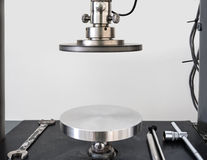Circular plate can press sample to calculate physical property o Royalty Free Stock Images