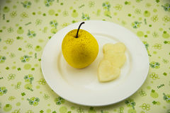 Circular plate, fresh pear Royalty Free Stock Photo