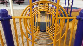 Circular play structure. A colorful playground with a circular climbing structure, ready for kids to play Stock Images