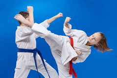 A circular punch and block are training boy and girl Stock Photo