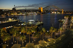 Circular quay. Night shot of circular quay in sydney; harbour bridge in background stock photo