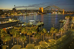 Circular Quay. In Sydney, night photo, harbour bridge in background stock photography