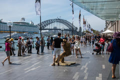 Circular Quay Crowds and Busker. SYDNEY,NSW,AUSTRALIA-NOVEMBER 20,2016:  Circular Quay waterfront with Sydney Harbour Bridge view, crowds, cruise ship, busker Royalty Free Stock Photography