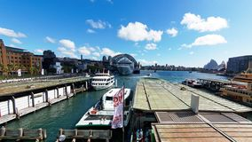 Circular Quay Ferries and the Sydney harbour Bridge, Australia. View over Circular Quay, Sydney Harbour, Sydney, NSW, Australia, with ferry terminal buildings stock photography