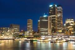 Circular Quay modern cityscape at night. Sydney, Australia Royalty Free Stock Images