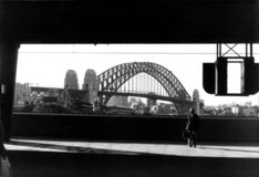 Circular Quay Station. A shot of a man on the station in the evening sun. The Sydney Harbour Bridge is in the background but appears as the subject of the Stock Images