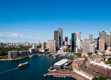 Circular Quay in Sydney. Circular Quay business district in Sydney Australia with a ferry entering the harbor royalty free stock photos