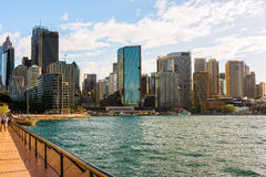 Circular Quay Sydney Australia. Area is a popular neighborhood for tourism and consists of walkway, pedestrian malls, park, Sydney Harbour Bridge and Sydney Royalty Free Stock Image