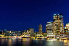 Circular Quay and  Sydney Business District Centre. Circular Quay,  Sydney Business District Centre, train and ferry station at night, with illuminated Royalty Free Stock Image