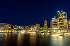 Circular Quay and  Sydney Business District Centre. Circular Quay,  Sydney Business District Centre, train and ferry station at night, with illuminated Stock Photos