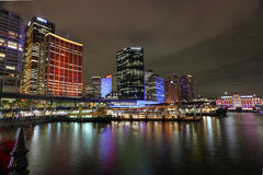 Circular Quay and Sydney City Buildings in colour during Vivid S. SYDNEY, AUSTRALIA - JUNE 3, 2014; Circular Quay and Sydney City CBD buildings in vibrant colour royalty free stock photo