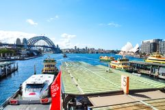 Circular quay wharf with the view of Sydney harbour bridge and opera house. royalty free stock photography