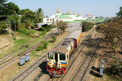 Circular Railway Train leaves Yangon Central Railway Station in Royalty Free Stock Images