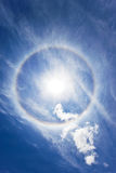 Circular rainbow around sun Stock Image