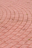 Circular red brick pavement pattern Stock Images
