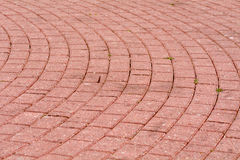 Circular red brick pavement pattern Royalty Free Stock Photography