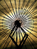 Circular ride. Detail of amusement ride center silhouetted against setting sun Royalty Free Stock Photo