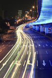 Circular road rainbow light trails night scene Royalty Free Stock Images