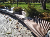 Circular row of benches in park Stock Photo