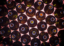 Circular rows of brown color bottles. Closeup circular rows of brown color bottles background Royalty Free Stock Photography