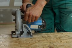 Circular Saw. Industrial electric job worker wood steel royalty free stock image