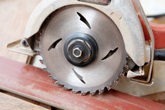 Circular saw. Sitting on board Stock Photo