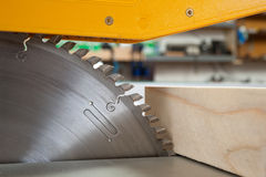 Circular saw. Cutting wooden plank royalty free stock images