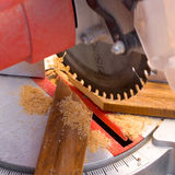 Circular saw. Cutting wooden plank Royalty Free Stock Photography
