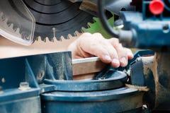 Circular saw. Man working with circular saw, selective focus Stock Image