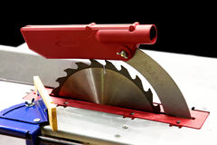 Circular saw. The machine with a circular saw for cutting of wooden boards stock image