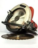 Circular saw. The circular saw is a machine using a toothed metal cutting disc or blade Stock Images