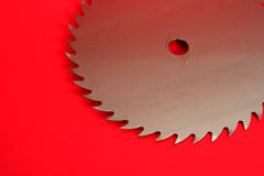 Circular Saw. Part of a circular saw on a red background Stock Photo