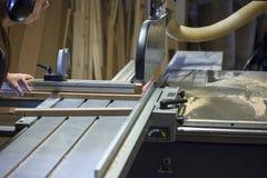 Circular saw blade at work Stock Image