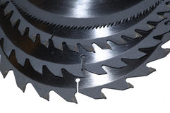 Circular saw blades. A nest of Circular saw blades of different sized teeth Royalty Free Stock Photography