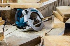 Circular Saw on boards. Closeup Stock Photos