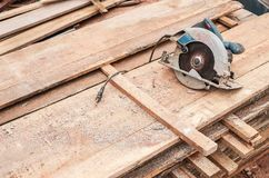 Circular saw Bosch GKS 190 Professional over a pile of wooden pl. Brazil - October 11, 2018: Illustrative editorial of a circular saw Bosch GKS 190 Professional stock images