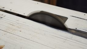 Circular saw. Carpentry. Close up of table saw blade, indoors stock footage