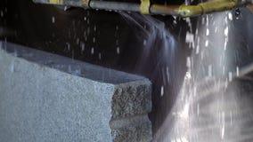 Cutting granite slab by a circular saw. stock footage