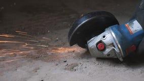 Circular saw cutting metal generating sparks. Worker grinding metal with handheld round circular saw