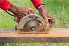 Circular saw cutting piece of wood Stock Images