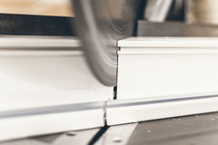 Circular Saw Cutting PVC Profile Close Up. Plastic Window and Do. Or Production stock images