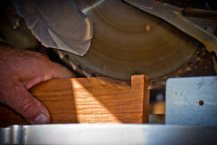 Circular saw cutting wood in carpentry Royalty Free Stock Images