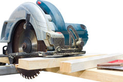 Circular saw cutting wood and iron ruler Royalty Free Stock Images